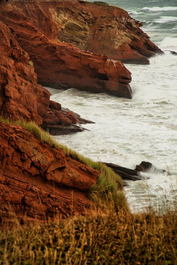 Free Red Cliff In Magdalen Islands Royalty Free Stock Images - 100033149