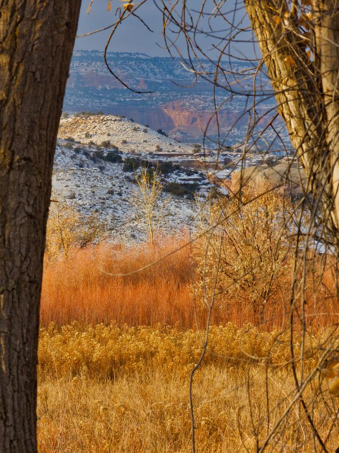 Red Cliffs in Distant Haze. Sunny in the valley with a storm moving in. Horsethief Canyon State Wildlife Area in western Colorado has views, migratory birds, and stock photos