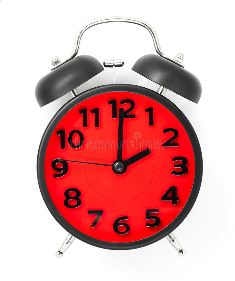 Red Clock with black frame pointing at 2 stock photo