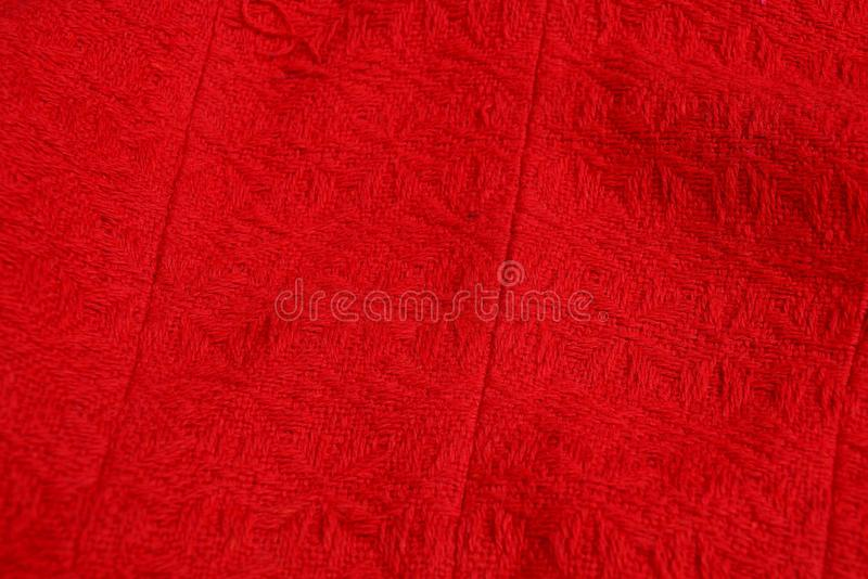 Red fabric texture from a piece of crumpled cloth on clothes. Red cloth background of a piece of crumpled matter on clothes royalty free stock image