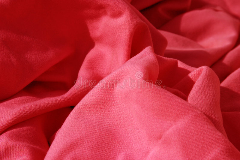 Red cloth table napkins clumped up and wrinkled. For background images royalty free stock images