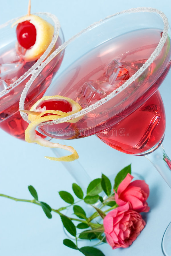 Red Cloud cocktail and coral mini rose stock image