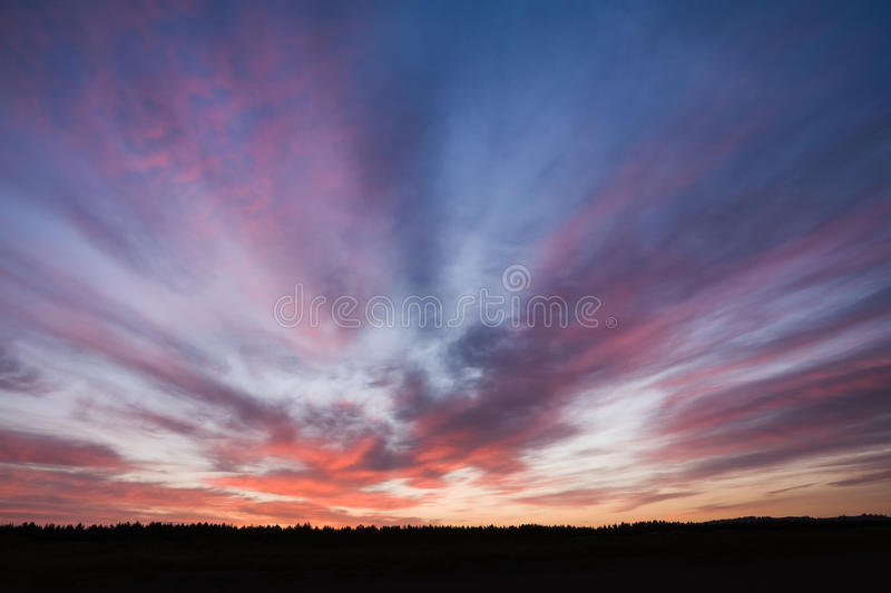 Red clouds at dawn stock photography