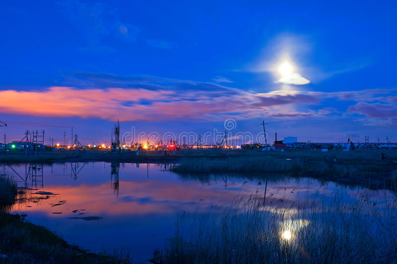 Red clouds and moonbeam. The photo was taken in Chenjia Dayuan lake Daqing city Heilongjiang province,China stock images