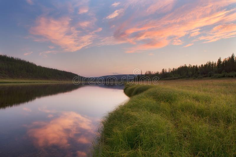 Red clouds over boreal river. royalty free stock photos