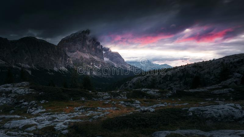 Red clouds of the sunrise with dramatic mountain landscape in th stock photography
