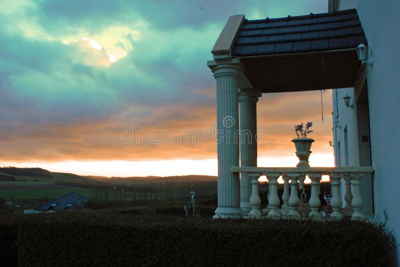 Entrance of an old landhouse in Tournehem-sur-la-Hem, France with sunset in the background stock image