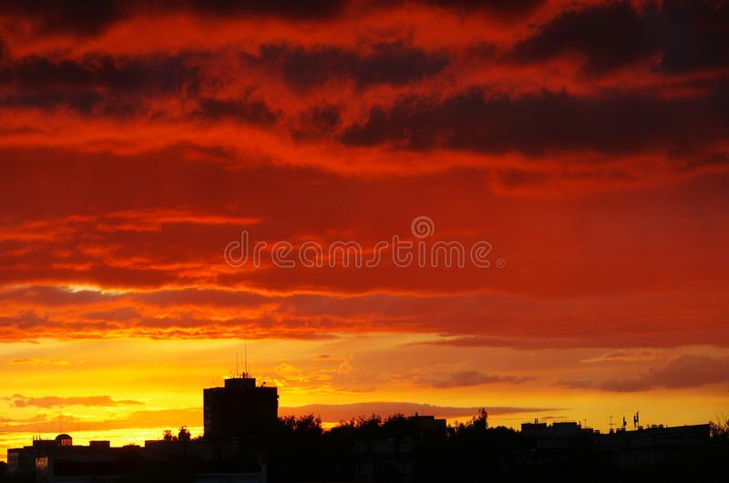 Red clouds. Sunset light. Red clouds. Cityscape royalty free stock photos