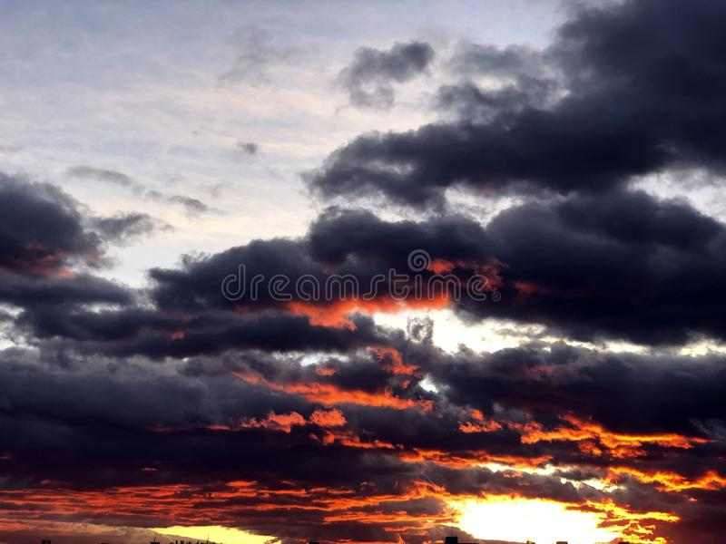 Fiery Red clouds during th sunset. Red clouds, sunset in Madrid stock images