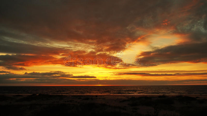 Red sky and clouds on sunset. Sunset and red clouds over sea royalty free stock images