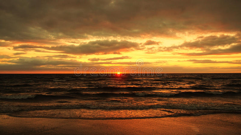Red sky and clouds on sunset. Sunset and red clouds over sea stock photo