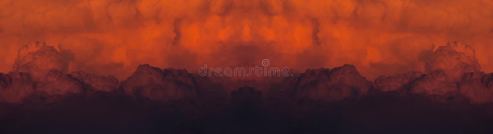 Red cloudy sunset after a huge forest fire. Abstract panoramic of a red cloudy sunset after a huge forest fire stock photo