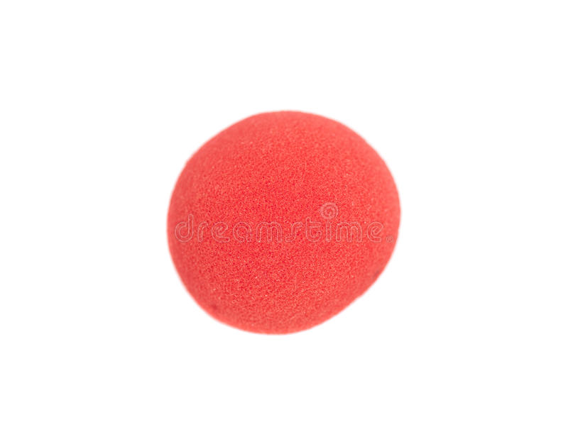 Red clown nose. Isolated on white royalty free stock photo
