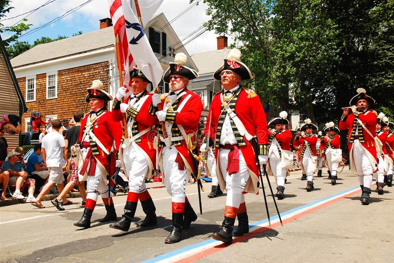 Red Coats on the Fourth of july. A group of adults, dressed in traditional British red coats, march in the Fourth of July Parade in Bristol, Rhode Island stock photography