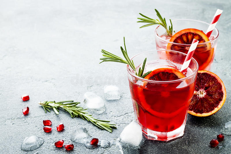 Red cocktail with blood orange and pomegranate. Refreshing summer drink. Holiday aperitif for Christmas party. royalty free stock image