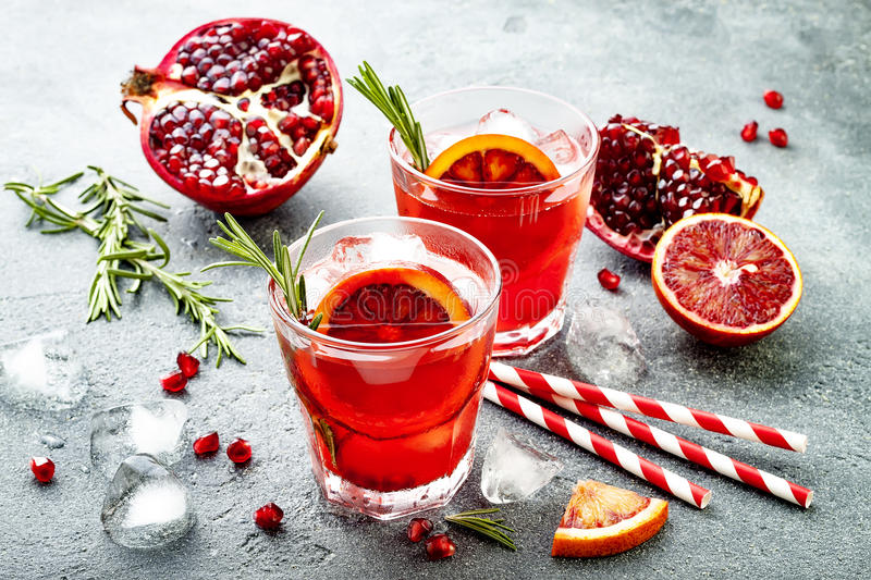 Red cocktail with blood orange and pomegranate. Refreshing summer drink. Holiday aperitif for Christmas party. Red cocktail with blood orange and pomegranate stock photography