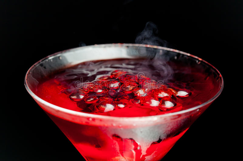 Red cocktail with bubbles royalty free stock image