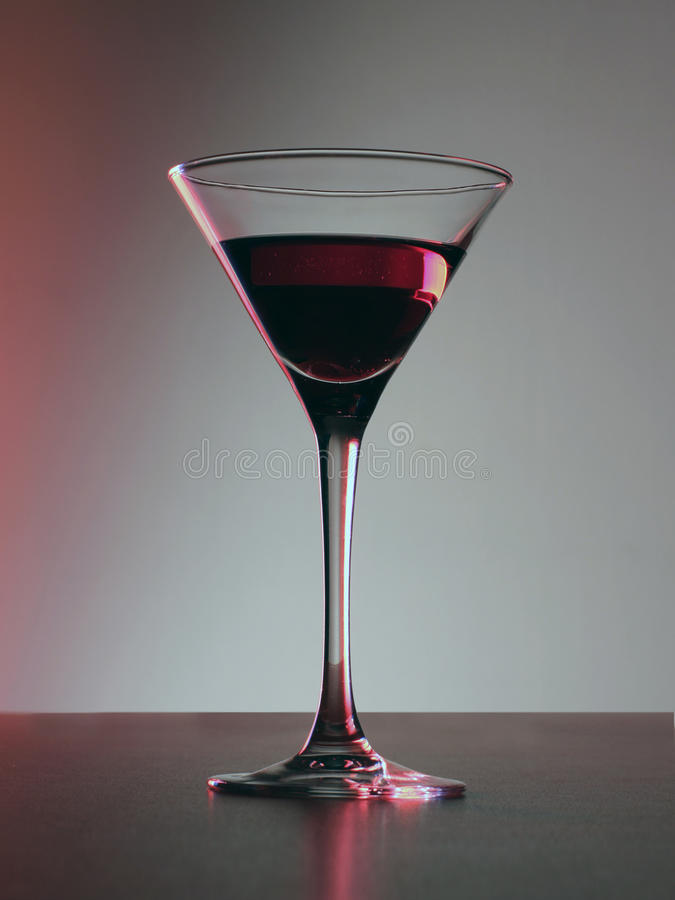 Red cocktail drink in tall glass stock photos