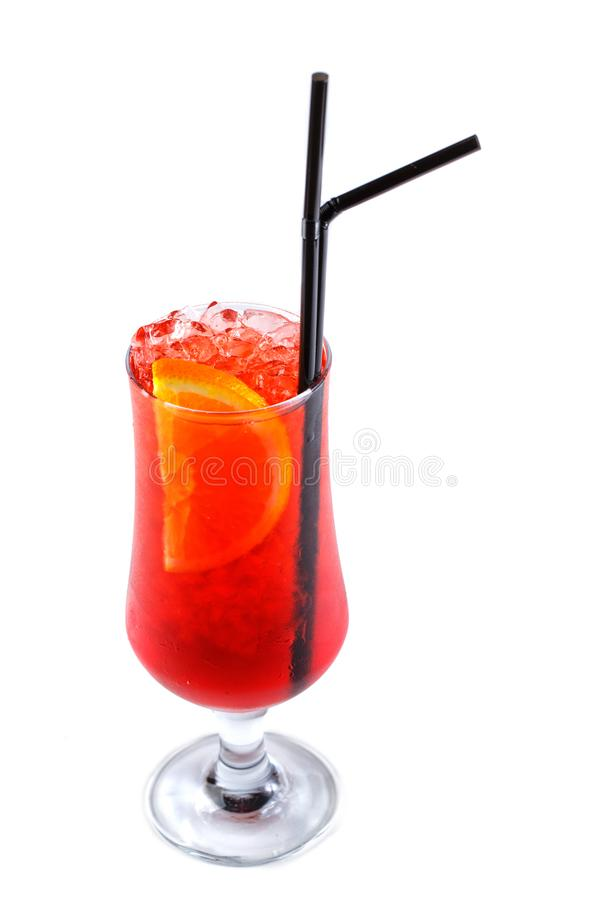 Red cocktail with ice and orange in a glass on an isolated white background royalty free stock images