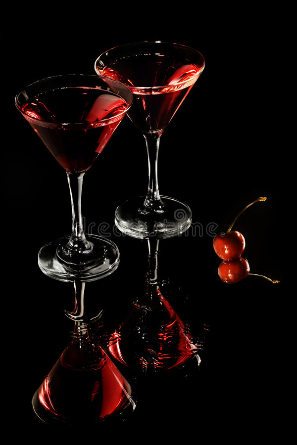 Red cocktail in martini glasses stock image