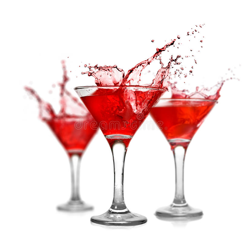 Red cocktails with splash on white royalty free stock photos