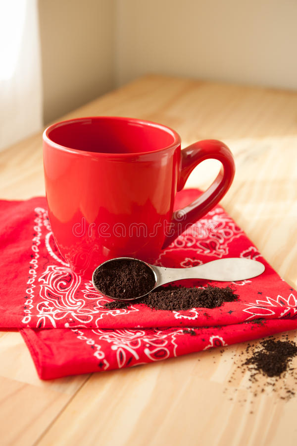 Red Coffee Mug with Napkin and Grounds stock images