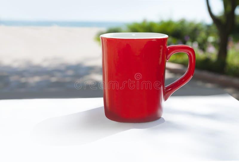 Red coffee mug. Overlooking the sun shine stock photography