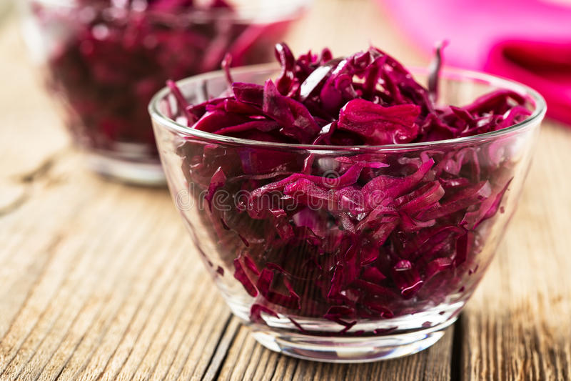 Red coleslaw on wooden background stock images