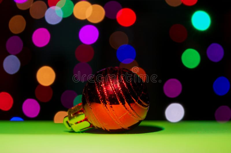 red color Christmas ornament ball with colorful bokeh background royalty free stock photos