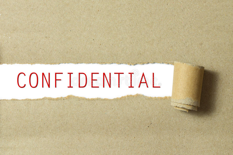 Red color confidential word. Written on torn paper white background royalty free stock photo