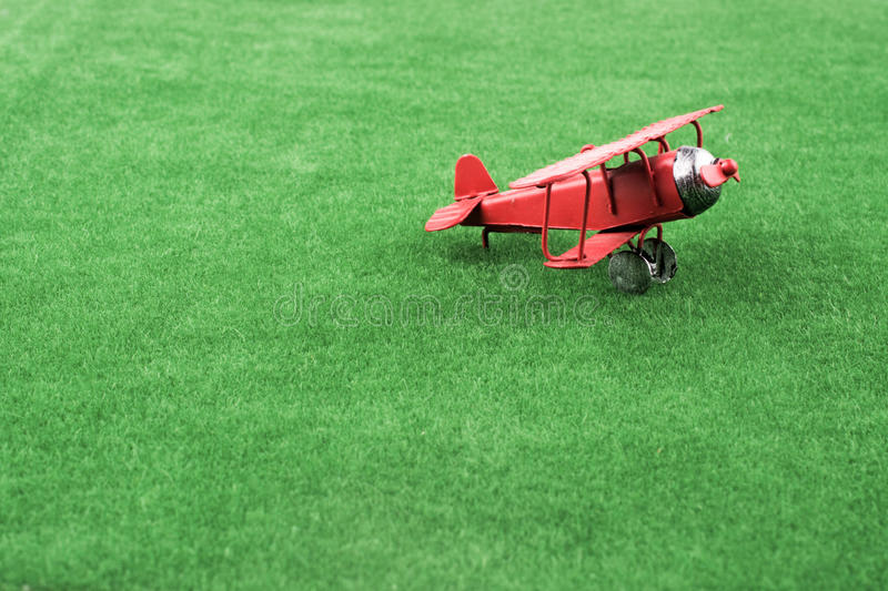 Red color little model airplane royalty free stock photography