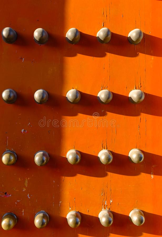 Red color old Chinese wood door with metal knob background stock photo