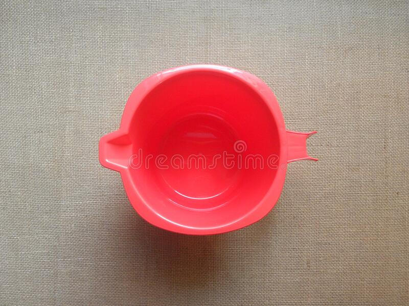 Red color plastic mug royalty free stock images