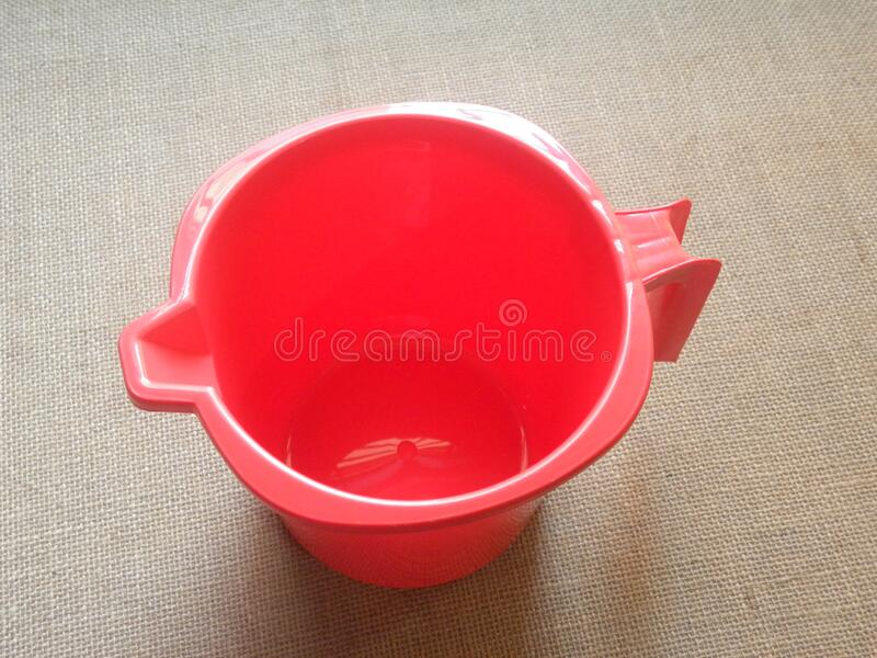 Red color plastic mug isolated royalty free stock images