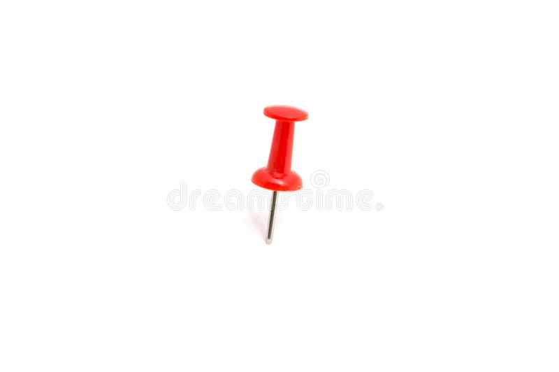 Red color push pin and on isolated white background stock photography