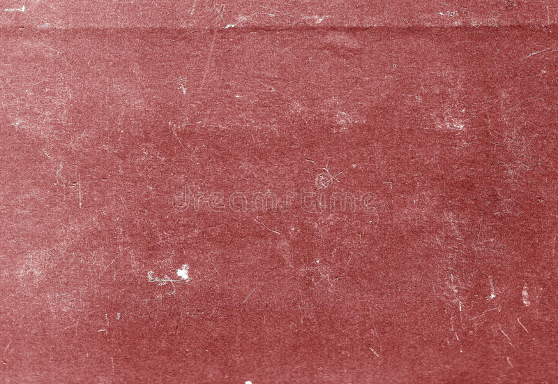 Red color scratched paper texture. stock photography