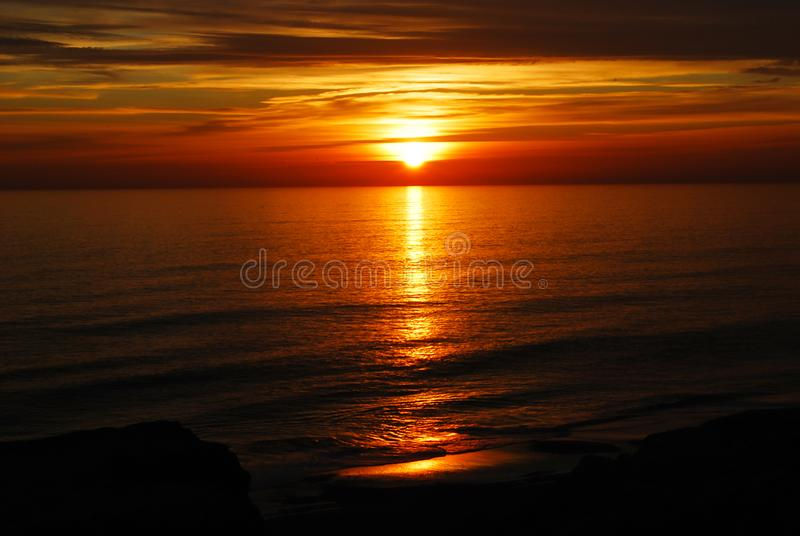 The red color of the sunset on the sea royalty free stock photo