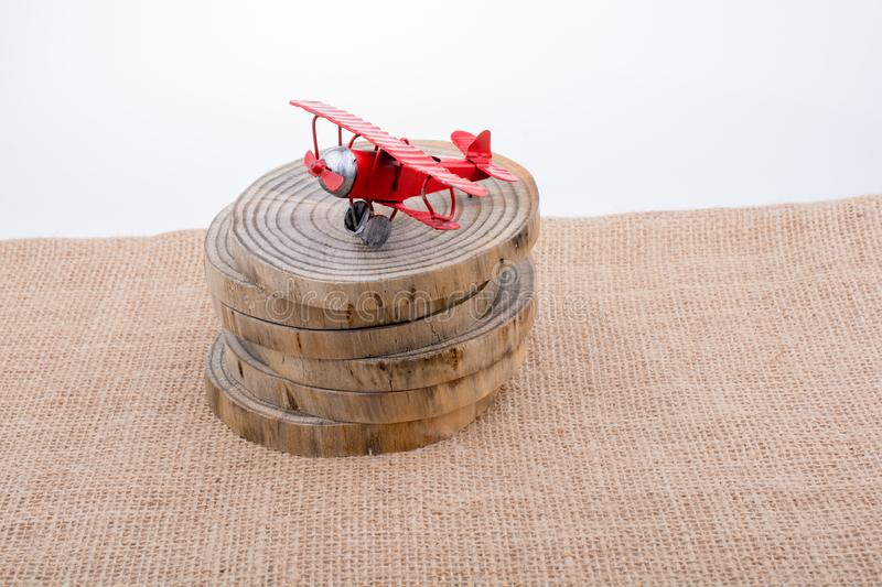 Red color toy plane on wooden texture stock image