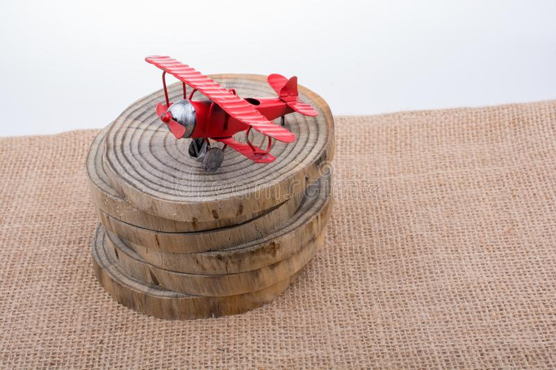 Red color toy plane on wooden texture stock photography
