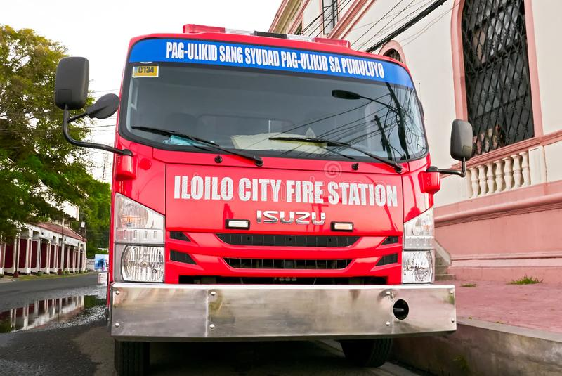 Red colored fire truck parking near the Iloilo fire station royalty free stock image