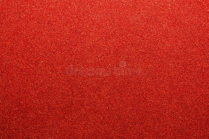 Red colored glitter paper texture or vintage background stock image