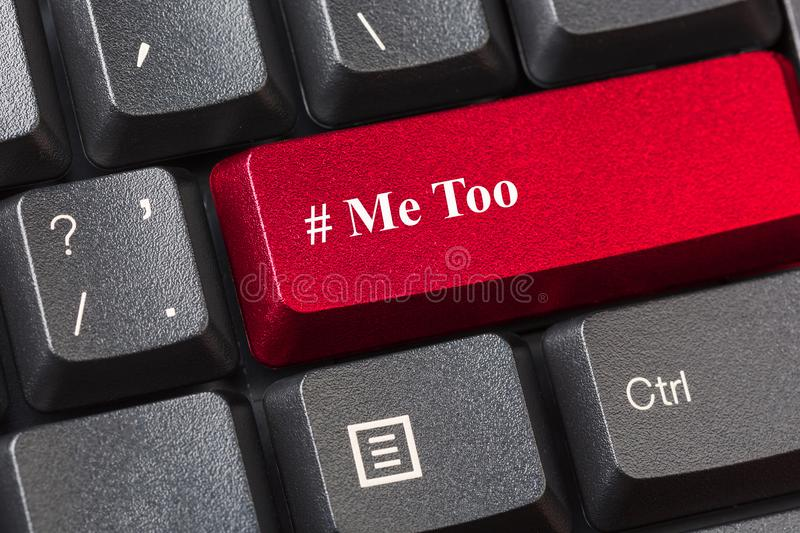 Red colored Me Too button on black computer keyboard. Sexual harassment concept. royalty free stock image