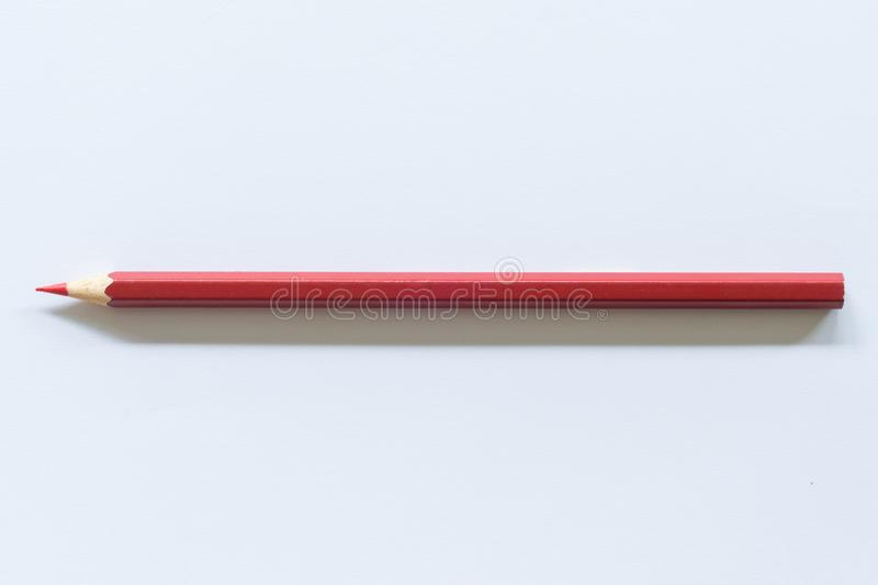 Red colored pencil  One single object, top view, bright tint. royalty free stock images