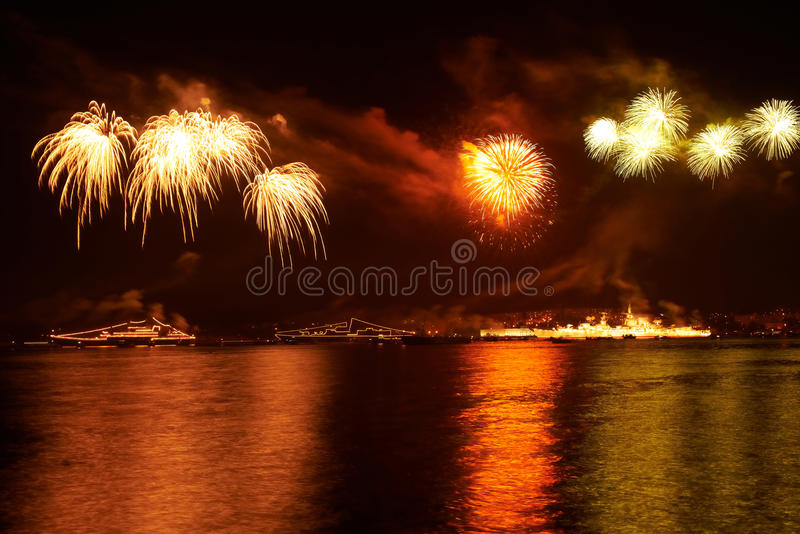 Red colorful fireworks. On the black sky background stock image
