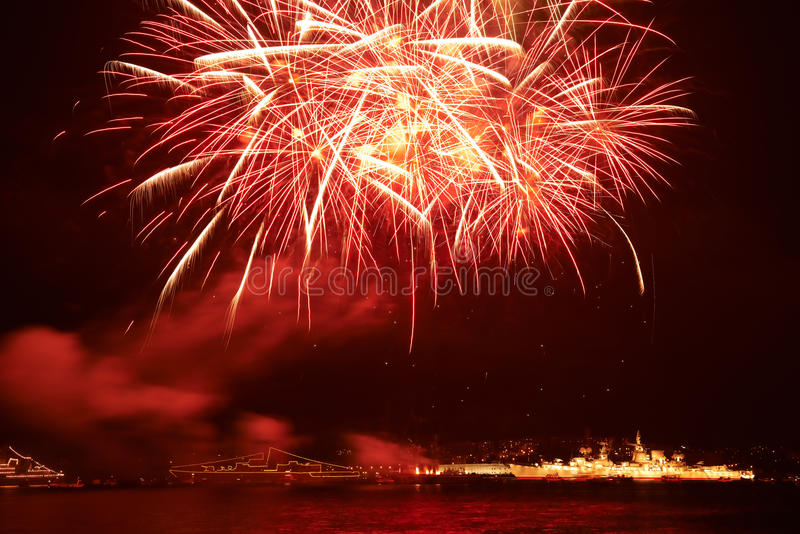 Red colorful fireworks. On the black sky background royalty free stock photos