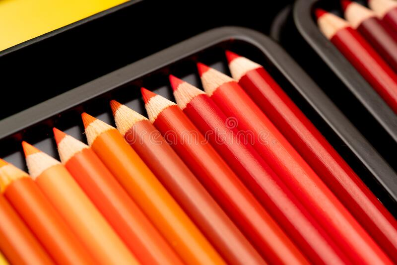 Red coloring pencils in a box stock photo
