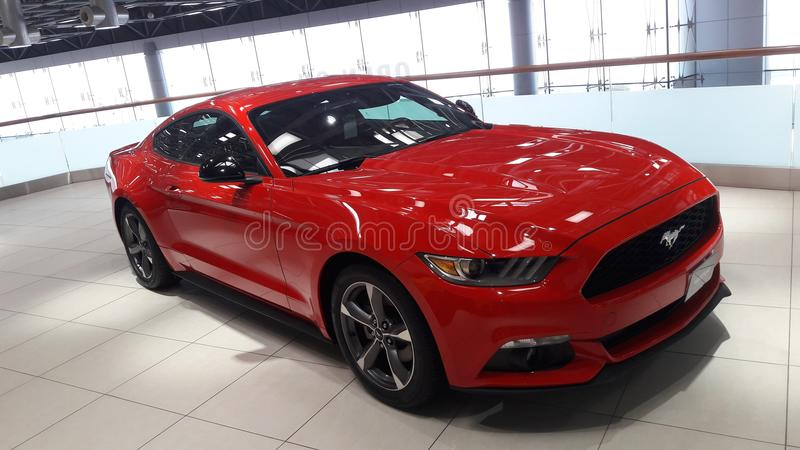 Red colour ford mustang car at showroom. High speed sport& x27;s car for racing beauty full design royalty free stock photos