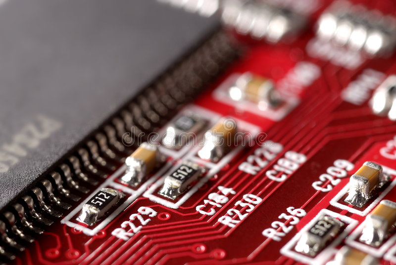 Red Computer Circuit Board. Close up of red computer circuit board with RAM memory chip stock photography
