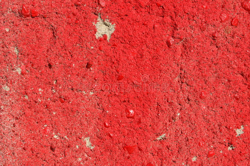Red concrete texture. Rough concrete wall airbrushed with red paint stock photography