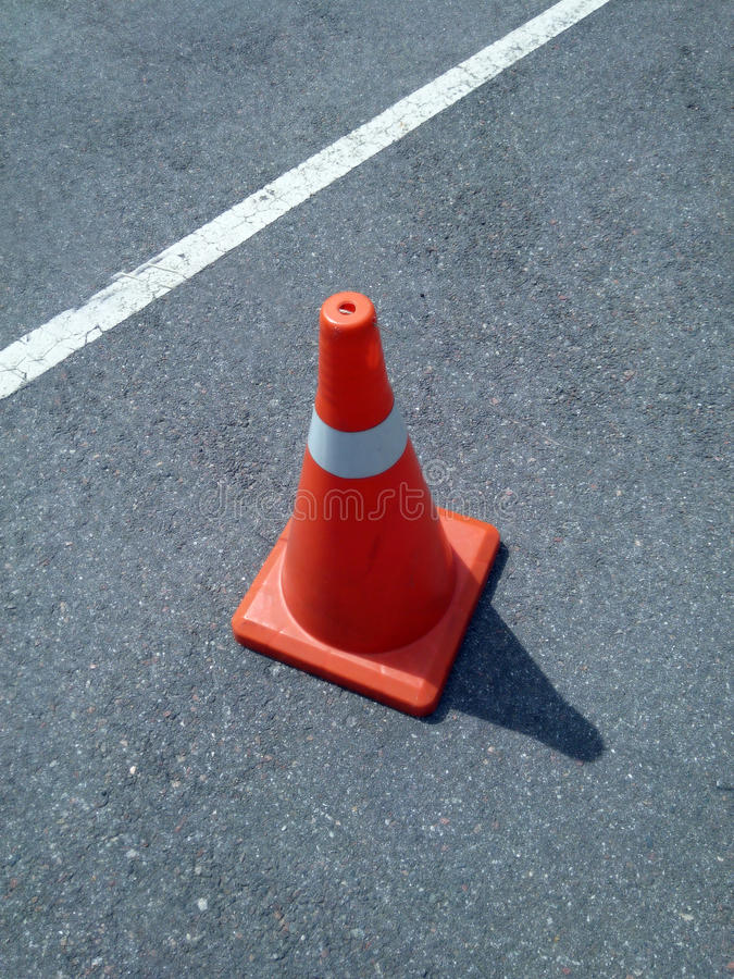 Red cone barrier. Limiter for cars on the road stock photo